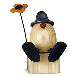 Egghead Father Anton  with flower sitting on edge, blue  -  15cm / 5.9inch